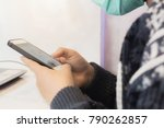 lady hands holding phone and... | Shutterstock . vector #790262857