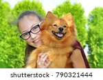 Stock photo portrait of happy young girl with her pet dog in nature 790321444