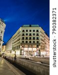 Small photo of Vienna, Austria - August 16, 2017: Street scene at night in Vienna in Michaelerplatz with Looshaus designed by Adolf Loos on background