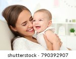 portrait of young mother with... | Shutterstock . vector #790392907