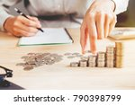 handles coins placed on a pile... | Shutterstock . vector #790398799