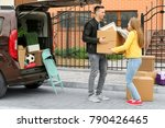 young couple unloading boxes... | Shutterstock . vector #790426465