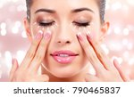 pretty woman massaging her face ... | Shutterstock . vector #790465837