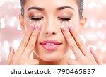 pretty woman massaging her face ... | Shutterstock . vector #790465837