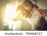 cute young daughter on a piggy... | Shutterstock . vector #790468717