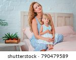 the daughter sits on the hands... | Shutterstock . vector #790479589
