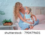 mom and daughter are sitting on ... | Shutterstock . vector #790479601