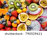 fresh fruits on a black... | Shutterstock . vector #790529611