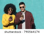 two happy friends using the... | Shutterstock . vector #790564174