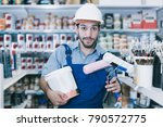 positive workman in blue... | Shutterstock . vector #790572775
