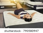 young woman lying on new... | Shutterstock . vector #790580947