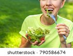 Woman Eating Healthy Salad From ...