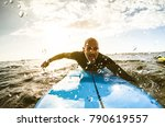 surfer guy paddling with... | Shutterstock . vector #790619557