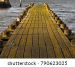 old wooden pier walkway... | Shutterstock . vector #790623025