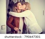 the elderly mother escorts her... | Shutterstock . vector #790647301