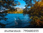 blue lake surrounded by forest... | Shutterstock . vector #790680355