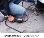 male mechanic repairing car's... | Shutterstock . vector #790708714