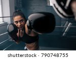 boxer practicing her punches at ... | Shutterstock . vector #790748755