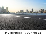empty urban road and modern... | Shutterstock . vector #790778611