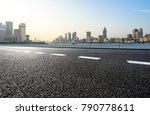 empty urban road and modern... | Shutterstock . vector #790778611