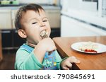 a hungry child is eating... | Shutterstock . vector #790845691