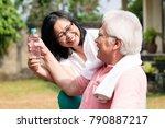 careful senior woman giving a... | Shutterstock . vector #790887217