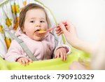 mother feeding her little baby... | Shutterstock . vector #790910329