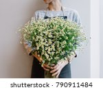 young florist holding in her... | Shutterstock . vector #790911484