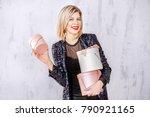 a successful blonde woman keeps ... | Shutterstock . vector #790921165