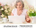 enior woman working with laptop  | Shutterstock . vector #790935925