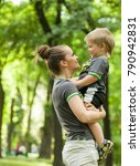 mom holds the son in his arms... | Shutterstock . vector #790942831