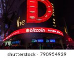 Small photo of LAS VEGAS, NEVADA, USA - JANUARY 1ST, 2018: The neon sign at entrance of The D, a casino and hotel at the Fremont Street Experience. The sign showing Bitcoin ATM available inside The D.