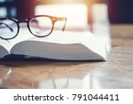 vintage glasses on books stack...   Shutterstock . vector #791044411