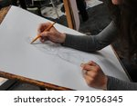 Small photo of Art student close-up an desk drawing Turin Italy circa September 2016