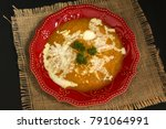 red plate with pumpkin soup on... | Shutterstock . vector #791064991