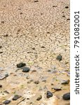 Small photo of travel in France - cracked bottom on shore of Gouffre gulf of English Channel after seasonal low tide near Plougrescant town of the Cotes-d'Armor department in Brittany in summer