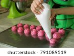 the confectioner girl squeezes... | Shutterstock . vector #791089519