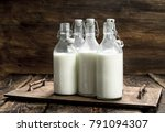 bottles with fresh milk. on a... | Shutterstock . vector #791094307