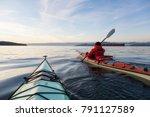 adventure man on a sea kayak is ...   Shutterstock . vector #791127589