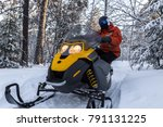 athlete on a snowmobile moving... | Shutterstock . vector #791131225