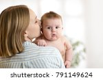 happy mother kissing her infant ... | Shutterstock . vector #791149624