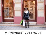 young woman looking at shoes... | Shutterstock . vector #791175724