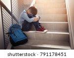 upset little boy sitting on... | Shutterstock . vector #791178451