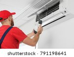 male technician cleaning air... | Shutterstock . vector #791198641