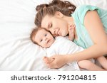 young mother and cute baby on... | Shutterstock . vector #791204815