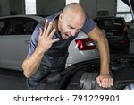 young car service technician... | Shutterstock . vector #791229901