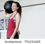 woman with medicine ball on... | Shutterstock . vector #791231605