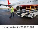 worker walking by conveyor... | Shutterstock . vector #791231701