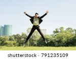 asia businessman jumping on the ... | Shutterstock . vector #791235109