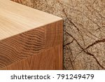 Small photo of Front view on corner of wooden bathroom table made of two flat wooden boards with wood texture and edges adjoined to marble wall lit with artificial light, FOCUS ON CORNER